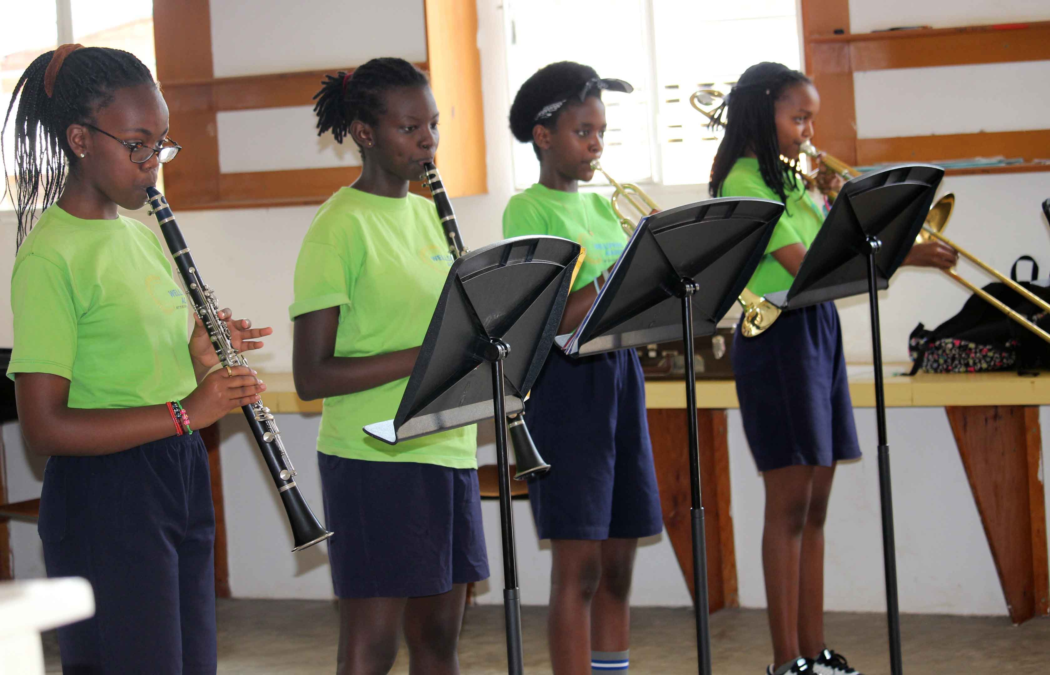 students playing band instruments